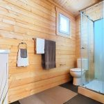 Bathroom natural timber walls