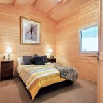 Bedroom natural timber walls
