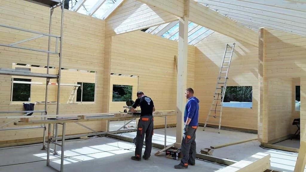 Builders inside loft house Europe