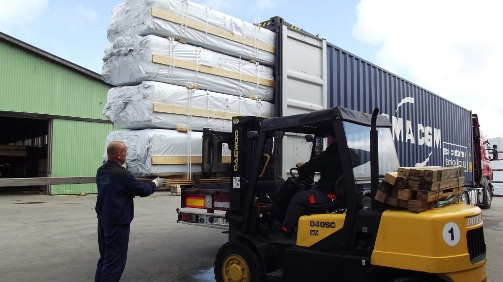 Loading kit homes into shipping container